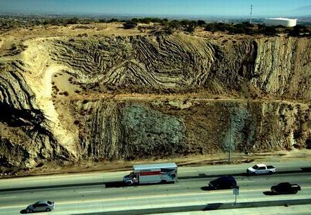 Highway 14 roadcut in Southern California exposes rocks squeezed by the San Andreas Fault at the roadcut's southern end