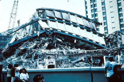 Figure 1: Wreckage of a twenty-one-story, steel-constructed building in the Pina Suarez Apartment Complex. Photo Mehmet Celebi, USGS