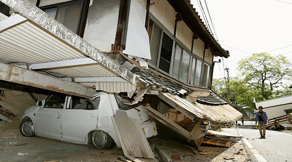 Photo showing car crushed by soft story in Japan