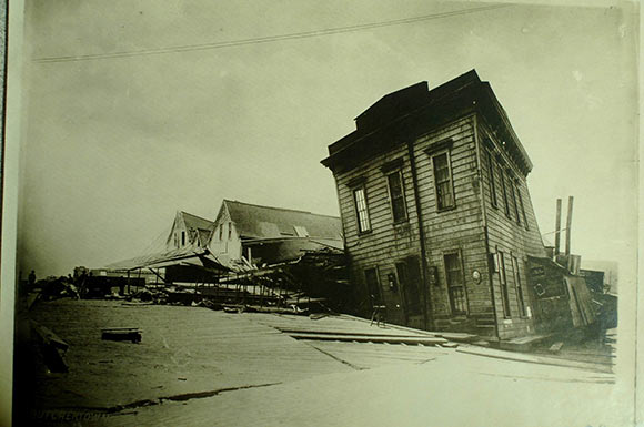 Historical photo of house damaged in 1906 quake.