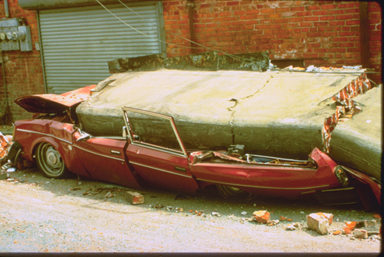 Photo of car crushed in Ferndale quake