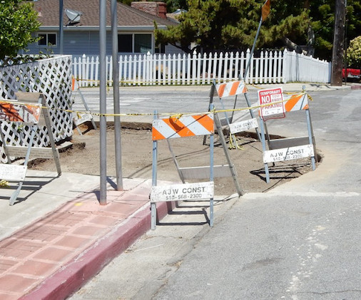 No more curb: a contractor has erased decades of fault creep.
