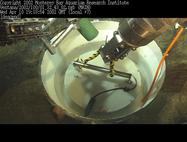 Filling the MOBB seismometer <br> with glass beads (c)2002 MBARI