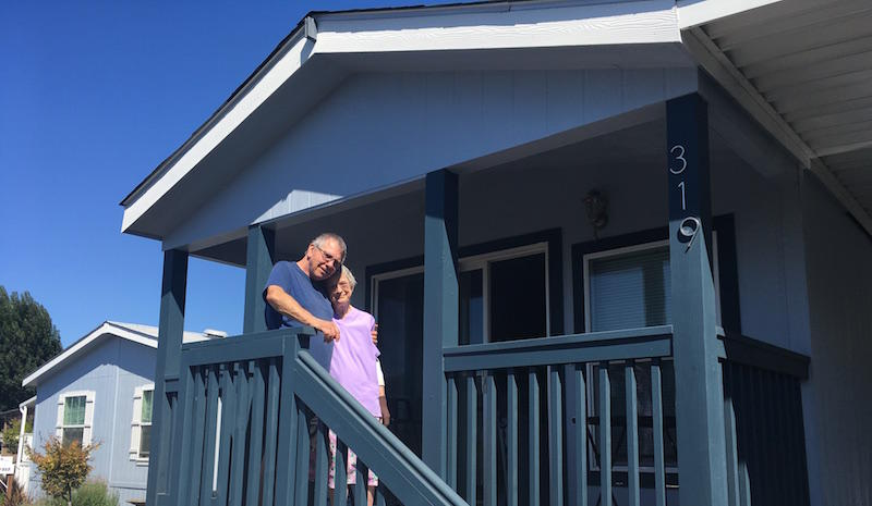 Barbara and Howard Hornsby stand in front of their new mobile home. Their old one was damaged in the 2014 earthquake.  - Angela Johnston