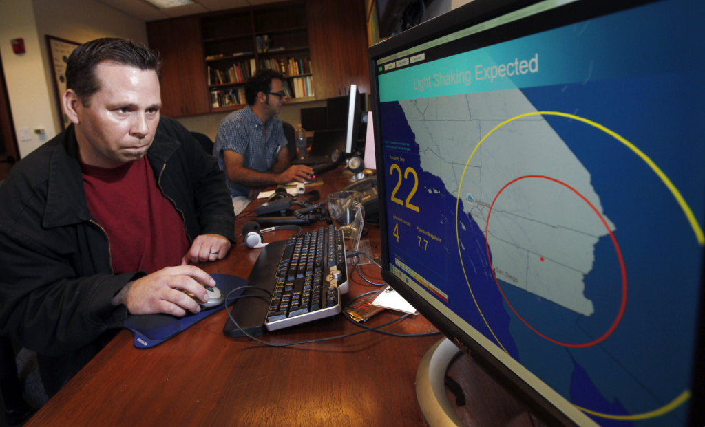 Analyst at CalTech shows demostration of earthquake early warning system