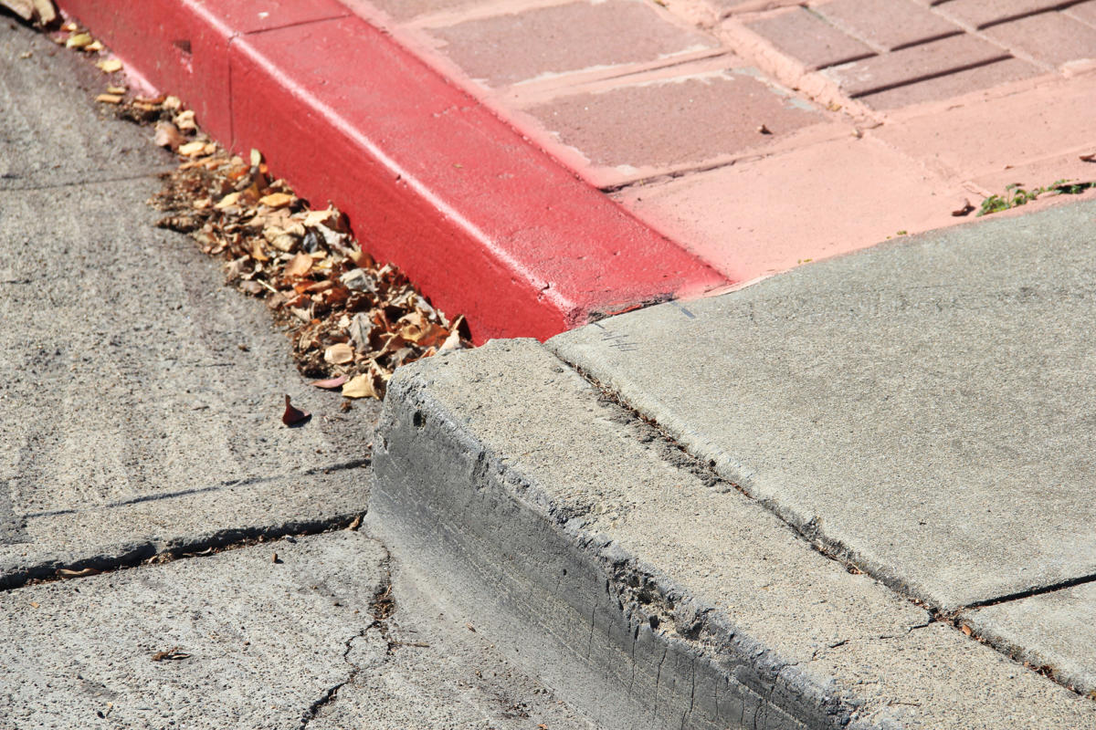 cement street curb offset due to slipping Hayward Fault